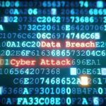 """Computer code, with phrases """"Data Breach"""" and """"Cyber Attack"""""""