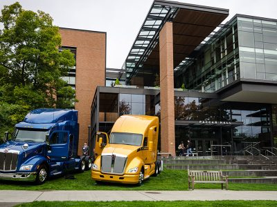 PACCAR trucks in front of PACCAR hall