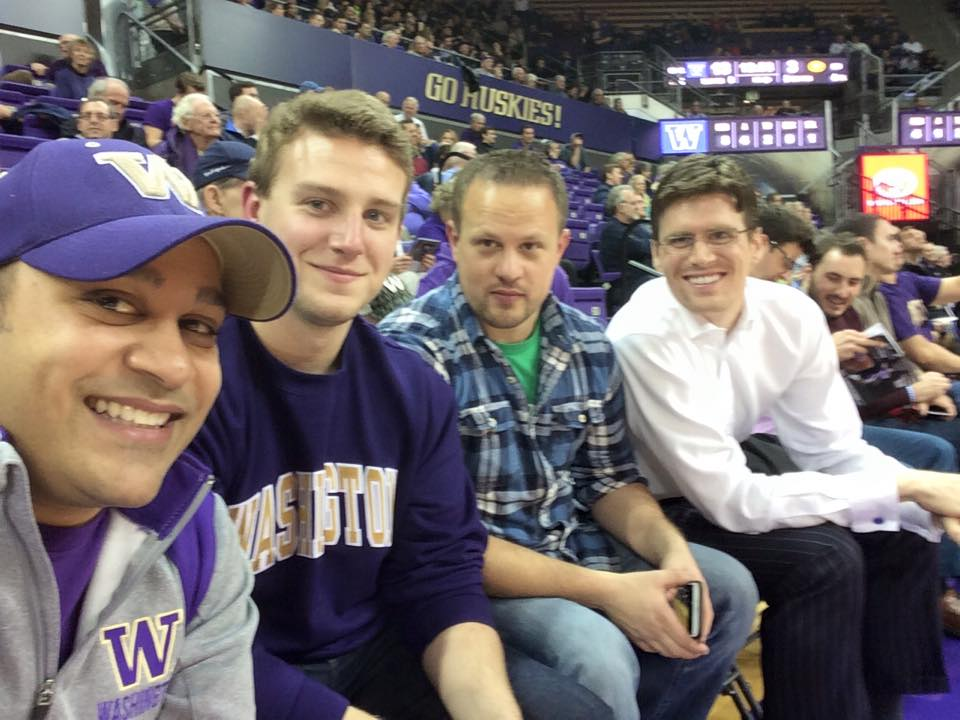 Tim with Foster classmates at a Husky game.